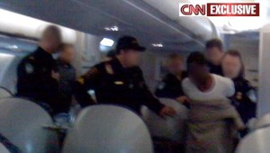 Police haul terror suspect off the plane