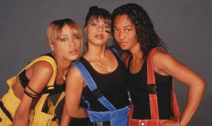 TLC with Lisa 'Left Eye' Lopes (centre) Rest In Peace
