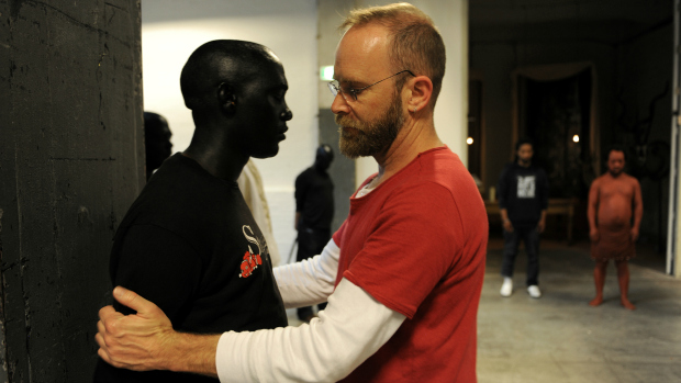 South African artist/director Brett Bailey seen here positioning a performer Photo credit: Sofie Knijff