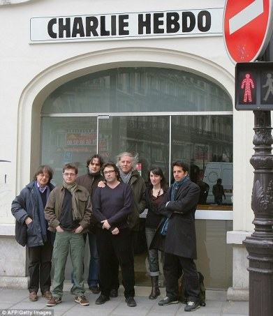 Staff of Charlie Hebdo, including cartoonists Cabu (left), Charb (second left), Tignous (fourth left) and Honore (fifth left) posing in front of the then headquarters of the weekly in Paris.