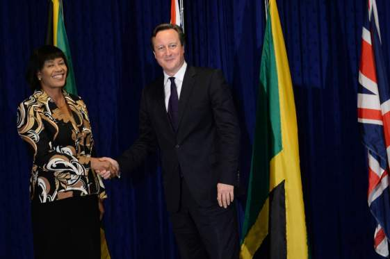 """Cameron visit to Caribbean - Day One. Prime Minister David Cameron is greeted by Jamaican Prime Minister Portia Simpson-Miller at her office, Jamaica House, in Kingston, on the first of a two day visit to the Caribbean. Picture date: Tuesday September 29, 2015. The Prime Minister flew into Jamaica promising a £200 million infrastructure aid boost to """"reinvigorate"""" ties with the region - with UK firms set to compete to build roads, ports and bridges. See PA story POLITICS Cameron. Photo credit should read: Stefan Rousseau/PA Wire URN:24284816"""
